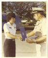 [Wendy Gellert receiving Certificate of Permanent Appointment for United States Navy, 1980]