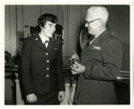 [Photograph of Airman Apprentice Wendy Gellert with Warrant Officer Snow]