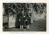 [Geneva Spratt Craig and friend pose in Williamsburg, Virginia by a trellis, circa 1944]
