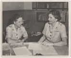[Colonel Julia E. Hamblet reviews documents, circa 1955]