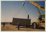 [Large container being moved by army personnel, 312th Evacuation Hospital, Saudi Arabia, 1991]