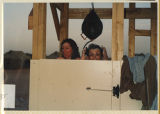[Army camp shower viewed from outside with two women inside, 312th Evacuation Hospital Saudi...