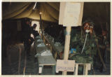 [Nina Harmon and other U.S. soldiers in tent on telephones, Saudi Arabia, 1991]