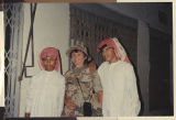 [Nina Harmon with two young Saudi Arabians, Saudi Arabia, 1991]