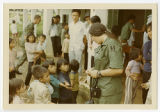 [Diane Kay Corcoran with Vietnamese children at a MEDCAP]