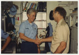 [Photograph of Jacqueline Edmunds receiving a badge aboard the USS Yellowstone (AD-41), 1992]