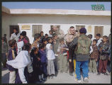 [Photograph of Army 1450 Transport Company HQ 1st Platoon distributing gifts in Safukin, Iran,...