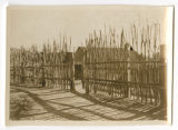 [Wooden palisade around Maori village, 1942]