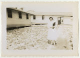 [Daphine Doster Mastroianni in front of nurses' quarters at basic training, 1942]