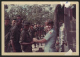 [Rita Barbraitis handing out water to soldiers, Vietnam, 1968]