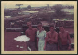 [Rita Barbraitis with soldiers at Base Camp Cu Chi, Vietnam, 1968]
