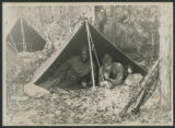 [Two soldiers in tent]