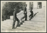 [Three soldiers walking up Dudley Hall steps, 1943]