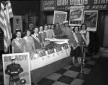 [Marinettes Posing with War Bonds Materials]