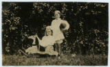 [Two children with a rocking horse]