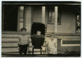 [Children in front of a house]