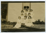 [Women posing in front of a house]