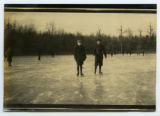 [Two boys ice skating]