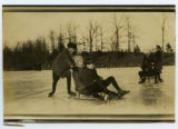 [Sledding on the frozen pond]