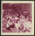 [A large gathering of students sitting on the floor in Shaw Dorm, 1957]
