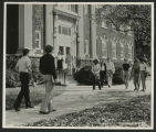 [Students walking on the sidewalk in front of the Forney Building]