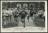 [Students running in a footrace in front of Hinshaw Residence Hall]