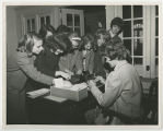 [Students Searching Boxes on Desk, circa 1965]