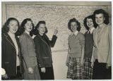 [Sisters in Front of a Map of North Carolina, 1946]