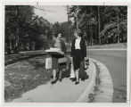 [Carrying Shopping Bags and Boxes, 1950s]