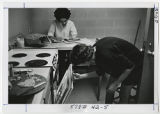 [Baking and Studying in Dorm Kitchen, 1967]