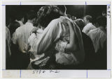 [Hugging in a Crowd, 1967]