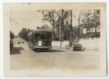 [A Street Car Trolley and Car Passing Campus, 1920s]