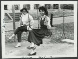 [Students Sitting on Swing Set, 1989]